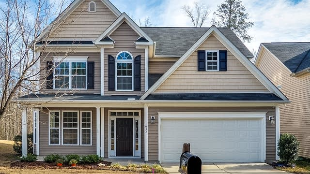 Photo 1 of 28 - 1033 Dexter Ridge Dr, Holly Springs, NC 27540