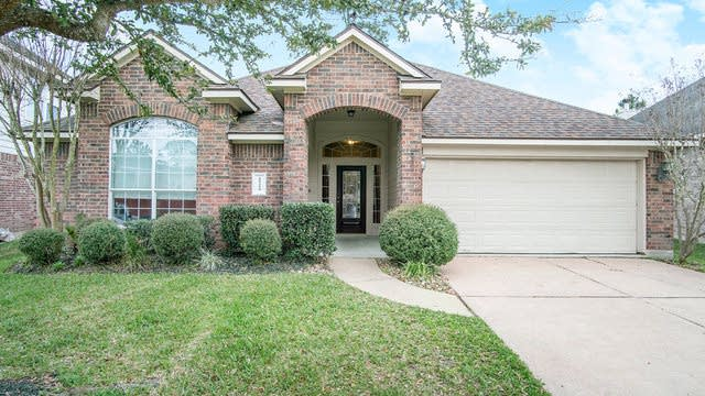 Photo 1 of 12 - 21215 Albany Park Ln, Spring, TX 77379