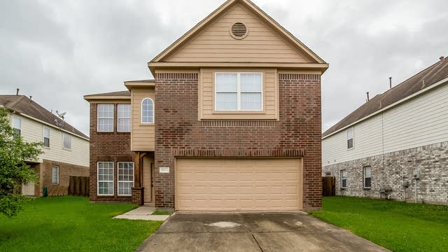 Photo 1 of 22 - 9715 Barr Spring Dr, Humble, TX 77396
