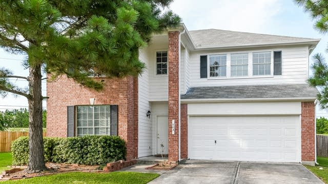 Photo 1 of 25 - 903 Pinecreek Point Ct, Spring, TX 77373