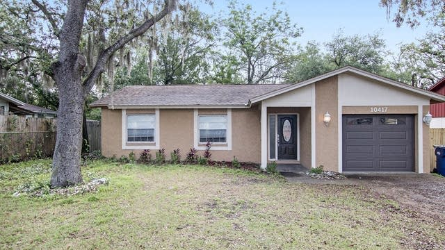 Photo 1 of 18 - 10417 N Connechusett Rd, Tampa, FL 33617